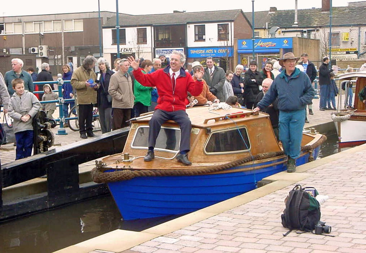 David Sumner, Chairman of Huddersfield Canal Society, aboard the first boat into Stalybridge.